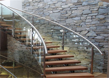 China Wooden Treads Curved Staircase Building Curved Stairs With Laminated Tempered Glass Railing supplier