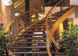 China Clear Finish 38mm Wood Tread Building Curved Stairs With 4mm Cable Railing supplier