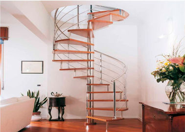 China Residential Steel Stair Custom Spiral Staircase With Solid Wood Treads supplier