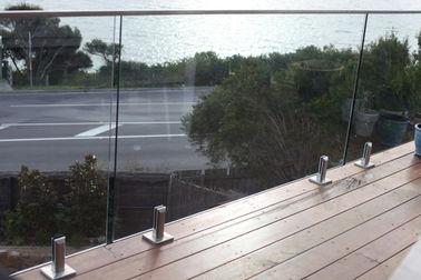 China Round Steel Frameless Glass Balcony Railing Outdoor With Solid Wood Handrail supplier