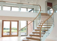 Solid Wood Apartment Stairs Carbon Steel Beam With Clear Tempered Glass Railing